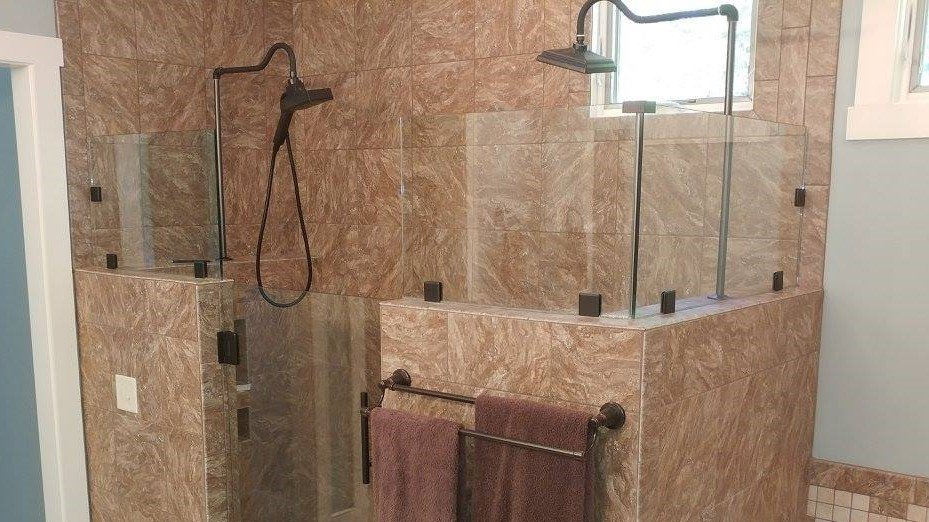 Update your bathroom with a glass shower door!