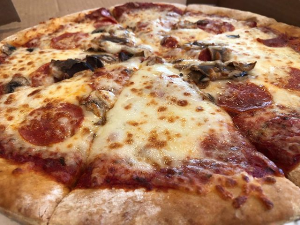 Have you tried the pizza at Wrigley Field Bar and Grill?
